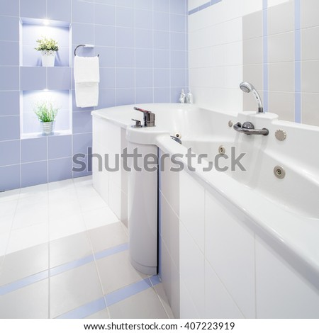 Big bathtub with massage in white luxury washroom
