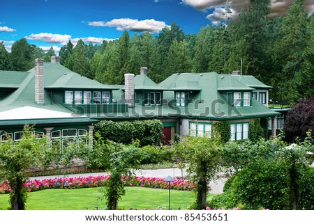 Big beautiful House with colorful landscaping in North America - stock photo