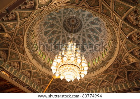 big beautiful lustre in a hall of Grand Mosque in Oman. the lights is on. - stock photo