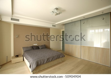 big bedroom with wide bed - stock photo