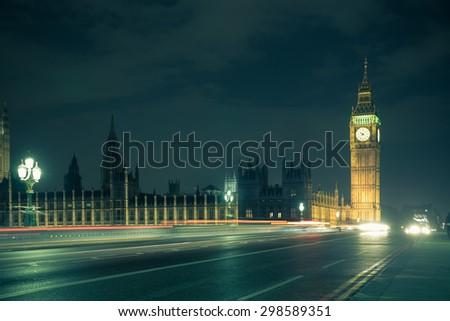 Big Ben across Westminster Bridge on a damp foggy night - stock photo