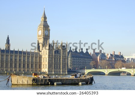 Big Ben and barge on the River Thames in London, England - stock photo
