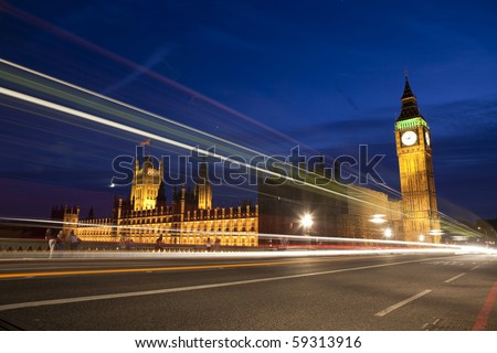 Big Ben and British Parliament with traffic lights. - stock photo