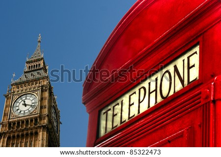 big ben and classic red telephone cabin on clean blue sky background - stock photo