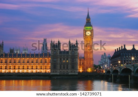 Big Ben and Houses of Parliament on the Thames River in London City Westminster at twilight - stock photo