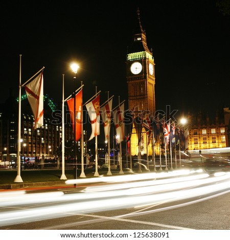 Big Ben and International Flags, seen from Parliament Square, at Night - stock photo