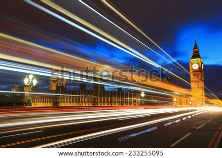 Big Ben and London at night with the lights of the cars passing by, the most prominent symbols of both London and England