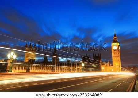 Big Ben and London at night with the lights of the cars passing by, the most prominent symbols of both London and England - stock photo