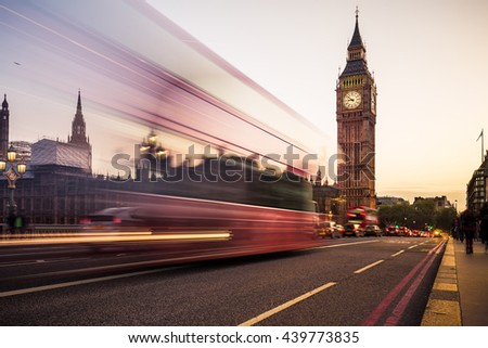 Big Ben and moving double-decker bus in London at sunset, UK. - stock photo