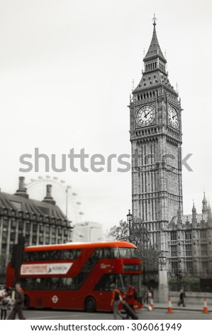 Big Ben and red double decker bus, tourists and London Eye. (London, UK). Retro aged photo. Blurred photo with selective focus on Big Ben tower.