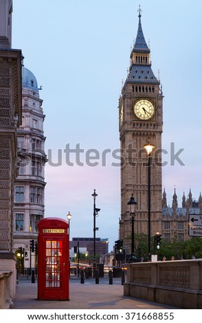 Big Ben and red London call box in the early morning, natural colors and lights