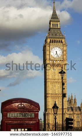 Big Ben and red phone booth - stock photo