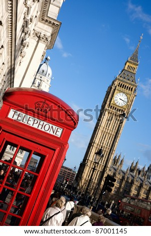 Big Ben and Red Phone Booth in Parliament Square in London - stock photo