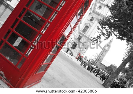 Big Ben and red phone booths in London - stock photo