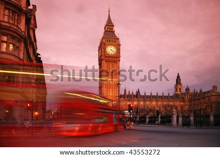 Big Ben and the Houses of Parliament at Westminster, taken at sunset, with busy London traffic trails in the foreground.
