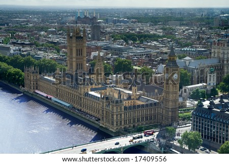 Big Ben and the Palace of Westminster, London. Aerial view including Westminster Abbey and Battersea Power-station. - stock photo