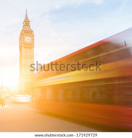 Big Ben and the typical red bus in motion, London - stock photo