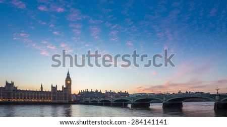 Big Ben and Westminster Bridge and Parliament with colorful clouds at dusk, London, UK - stock photo