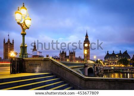 Big Ben and Westminster Bridge in London at Dusk. - stock photo