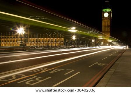 Big Ben at Night with Traffic in Bus Lane, London, England - stock photo