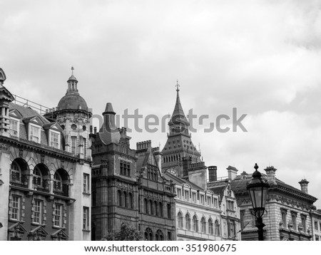Big Ben at the Houses of Parliament aka Westminster Palace seen from Parliament Street in London, UK in black and white - stock photo
