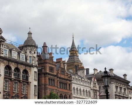 Big Ben at the Houses of Parliament aka Westminster Palace seen from Parliament Street in London, UK - stock photo