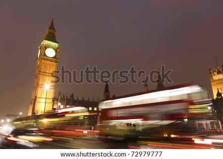 Big Ben behind light beams at twilight time, London, UK - stock photo