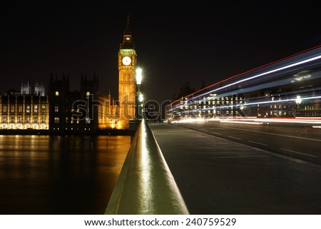 Big Ben, bus lights trail present, seen from Westminster Bridge at Night  - stock photo