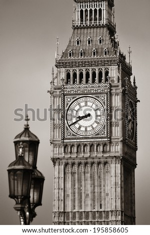 Big Ben closeup in London with vintage lamp post.