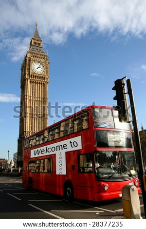 Big Ben - famous clock tower, the bigben, in City of Westminster, part of London with typical red double decker bus in foreground - stock photo