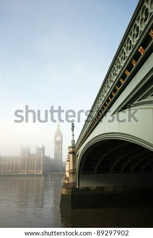 Big Ben in fog seen from Westminster Bridge - stock photo