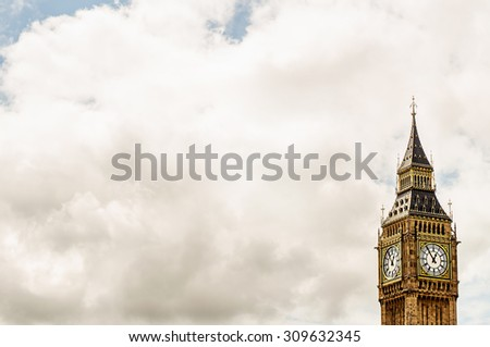 Big Ben in London, UK against cloud's sky background. Image with selective focus - stock photo