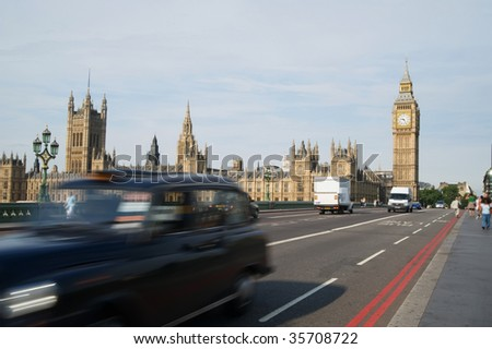 Big ben in London with black taxi in motion blur - stock photo
