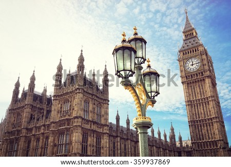 Big Ben in London with the houses of parliament and ornate street lamp - stock photo