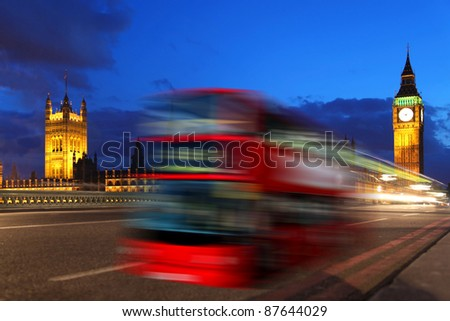 Big Ben in the evening with red bus in London, Uk - stock photo
