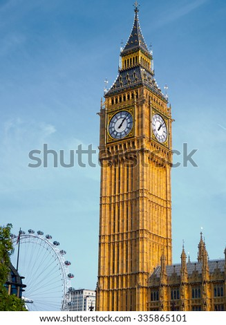 Big Ben London with London Eye in the Background - stock photo