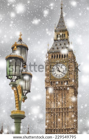 Big Ben on a winter snowy day against cloudy sky - stock photo