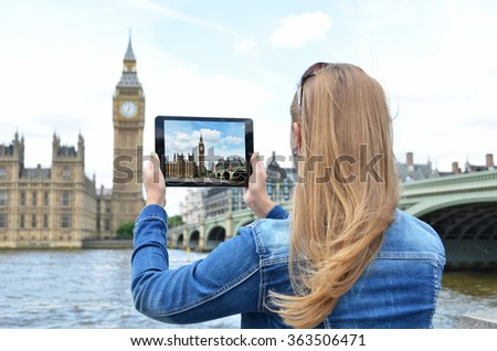 Big Ben on the screen of a tablet pc - stock photo