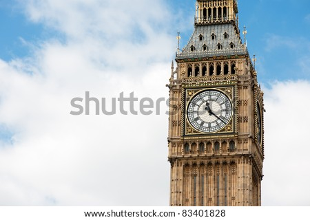 Big Ben over blue sky with white clouds for copy space. - stock photo