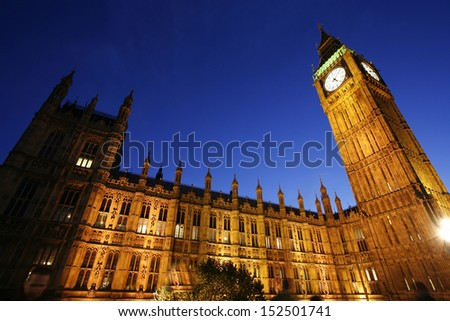 Big Ben, Palace of Westminster, seen from Westminster Bridge at Night   - stock photo