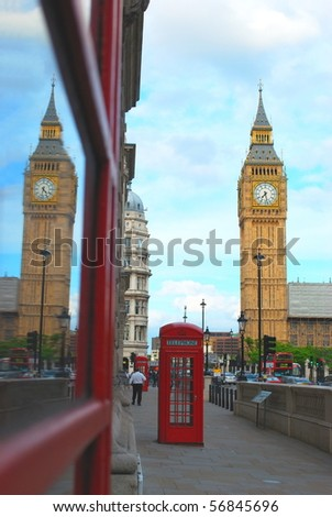 Big Ben reflected in public red telephone box