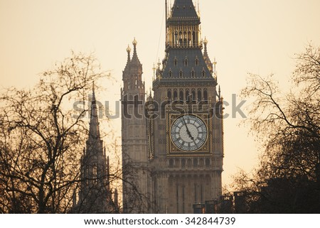 Big Ben, seen from Hungerford Bridge, Close up in the evening glow - stock photo