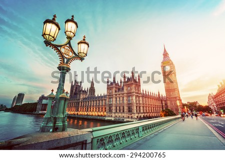 Big Ben seen from Westminster Bridge, London, the UK. at sunset. Retro street lamp light. Vintage - stock photo