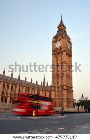 Big Ben, The Houses of Parliament and a  speeding London Double Decker Bus early on a Summer morning in London, UK.
