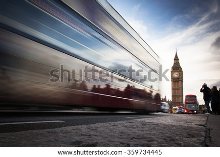 Big Ben, the Palace of Westminster red bus and tourists moving, London, UK - stock photo
