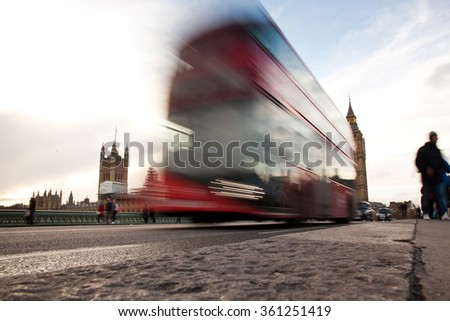 Big Ben, the Palace of Westminster, red bus and tourists moving, London, UK - stock photo