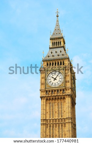 Big Ben Tower in detail against a blue sky - stock photo