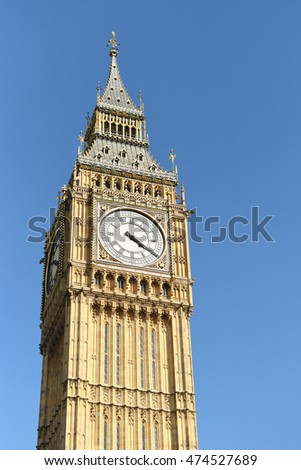 Big Ben tower in London, UK on a sunny day with blue skies
