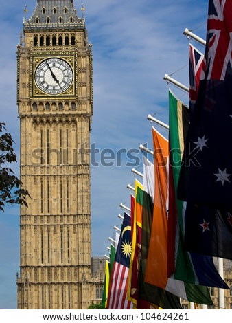 Big Ben tower with flags - stock photo