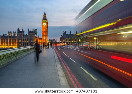 Big Ben viewed from Westminster Bridge with blurred red bus in the evening, UK